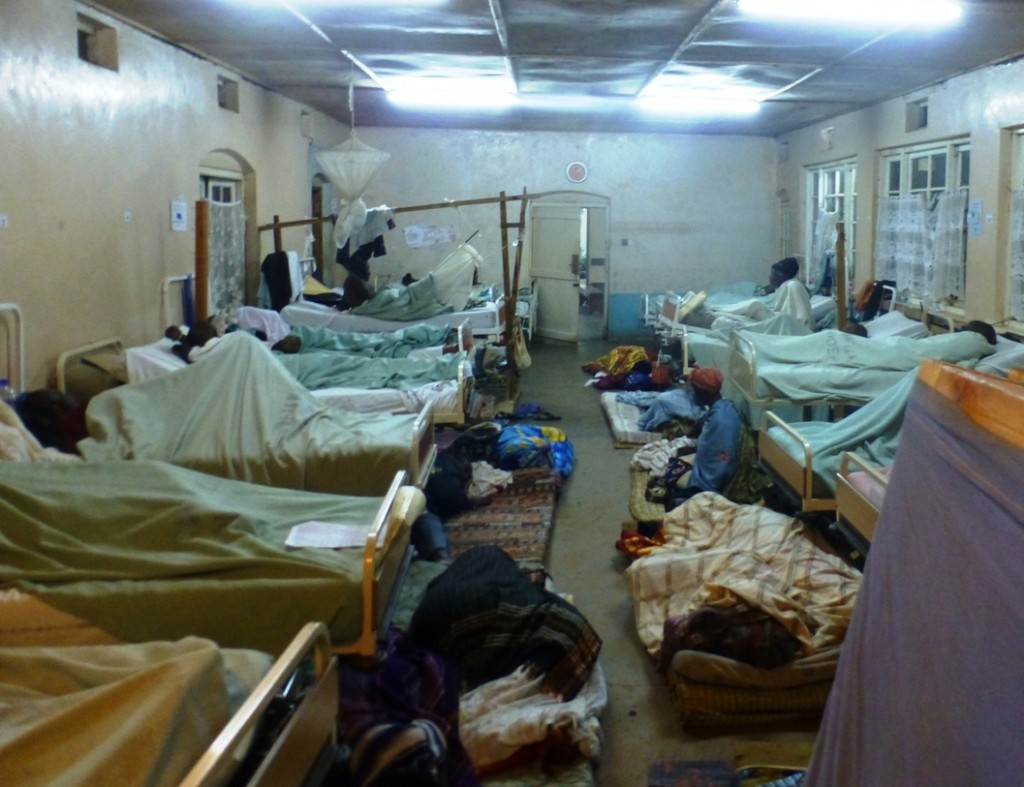 Mattresses on the floor of male surgical ward at night to take patients or their attendants..